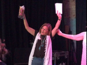 The spelling beer champ celebrates after being handed their prize!